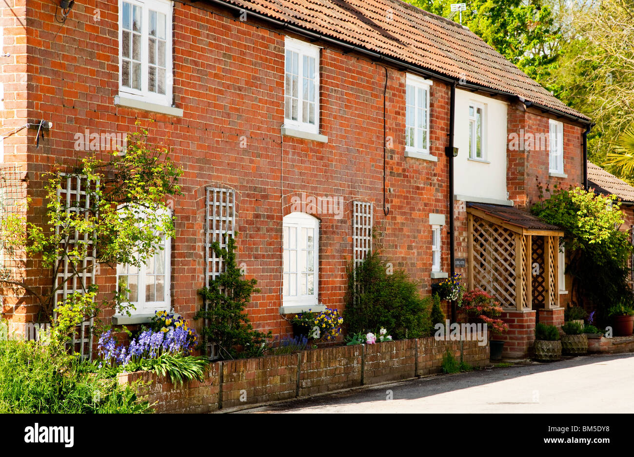 A red brick cottage in the Wiltshire village of Great Somerford, England, UK Stock Photo