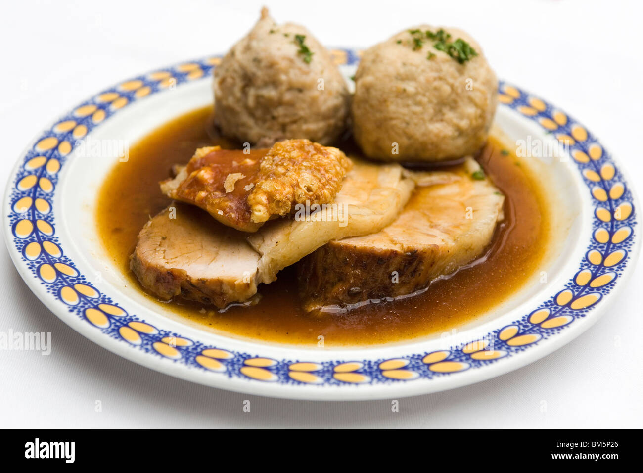 Roast Pork (Schweinesbraten) is served with crispy crackling and dumplings in Bavaria, Germany. - Stock Image
