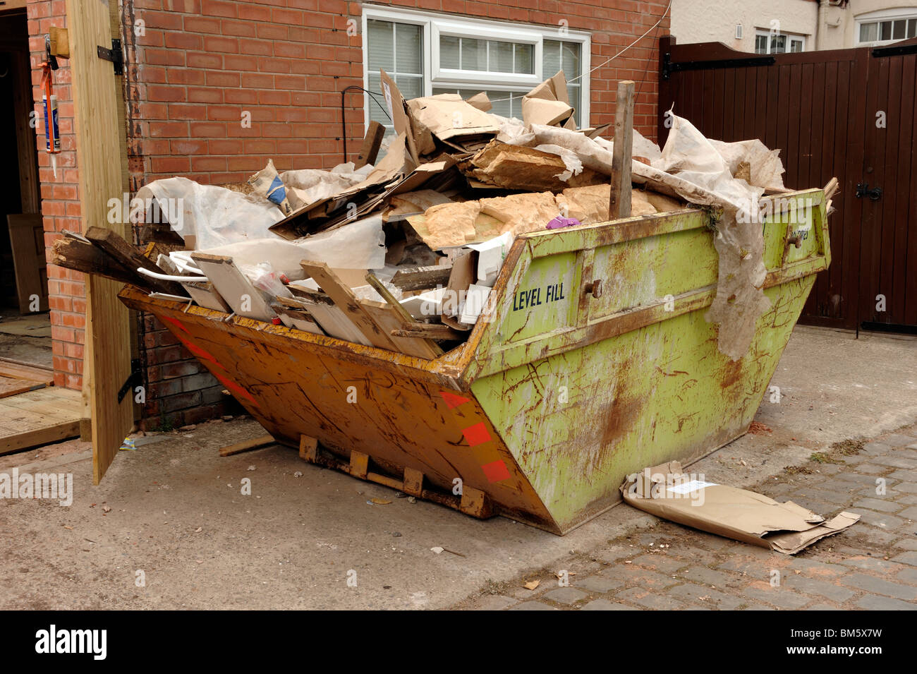 Skip full of rubbish - Stock Image