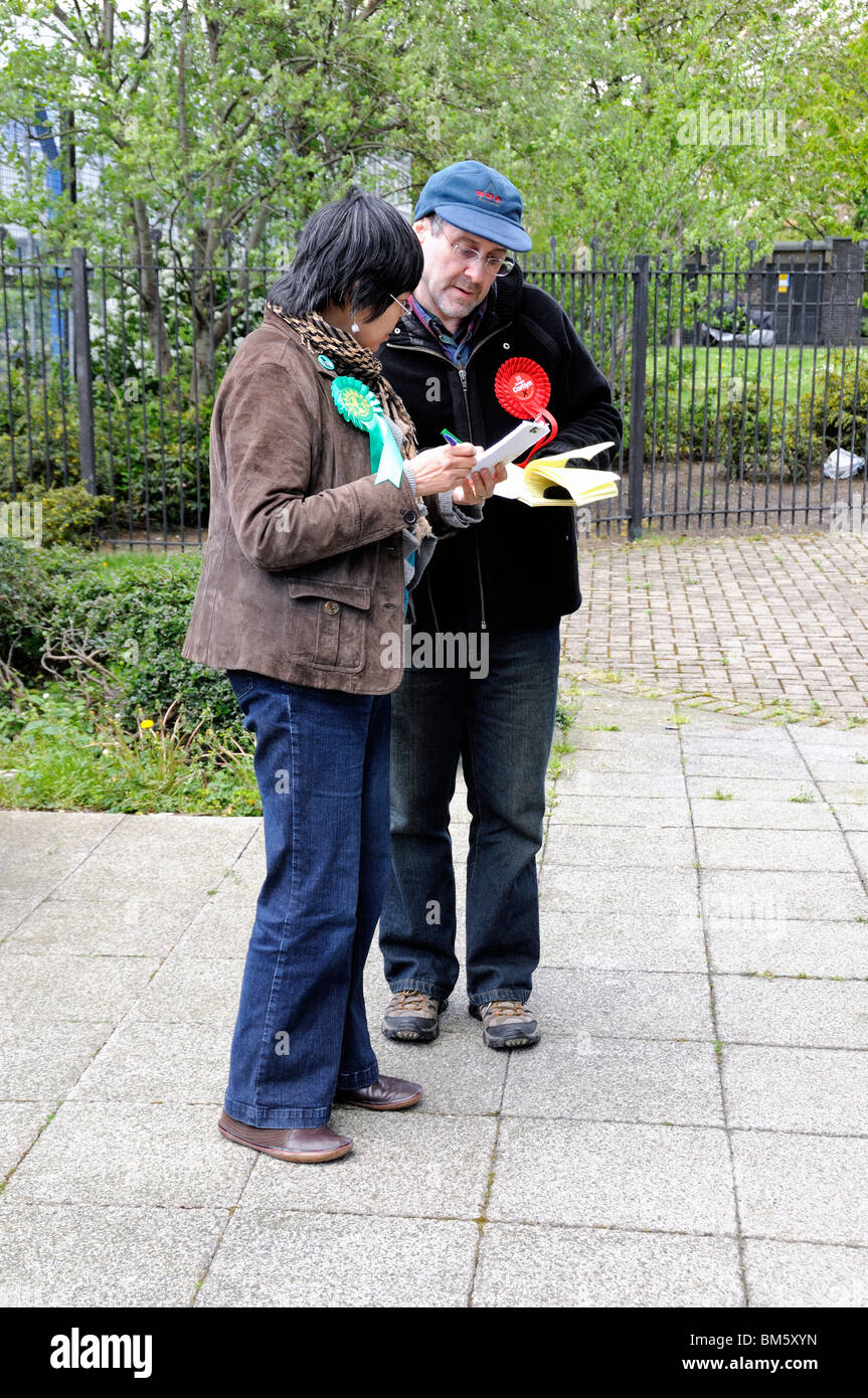 Green and Labour Party tellers comparing notes outside the Polling Station Islington North Constituency - Stock Image
