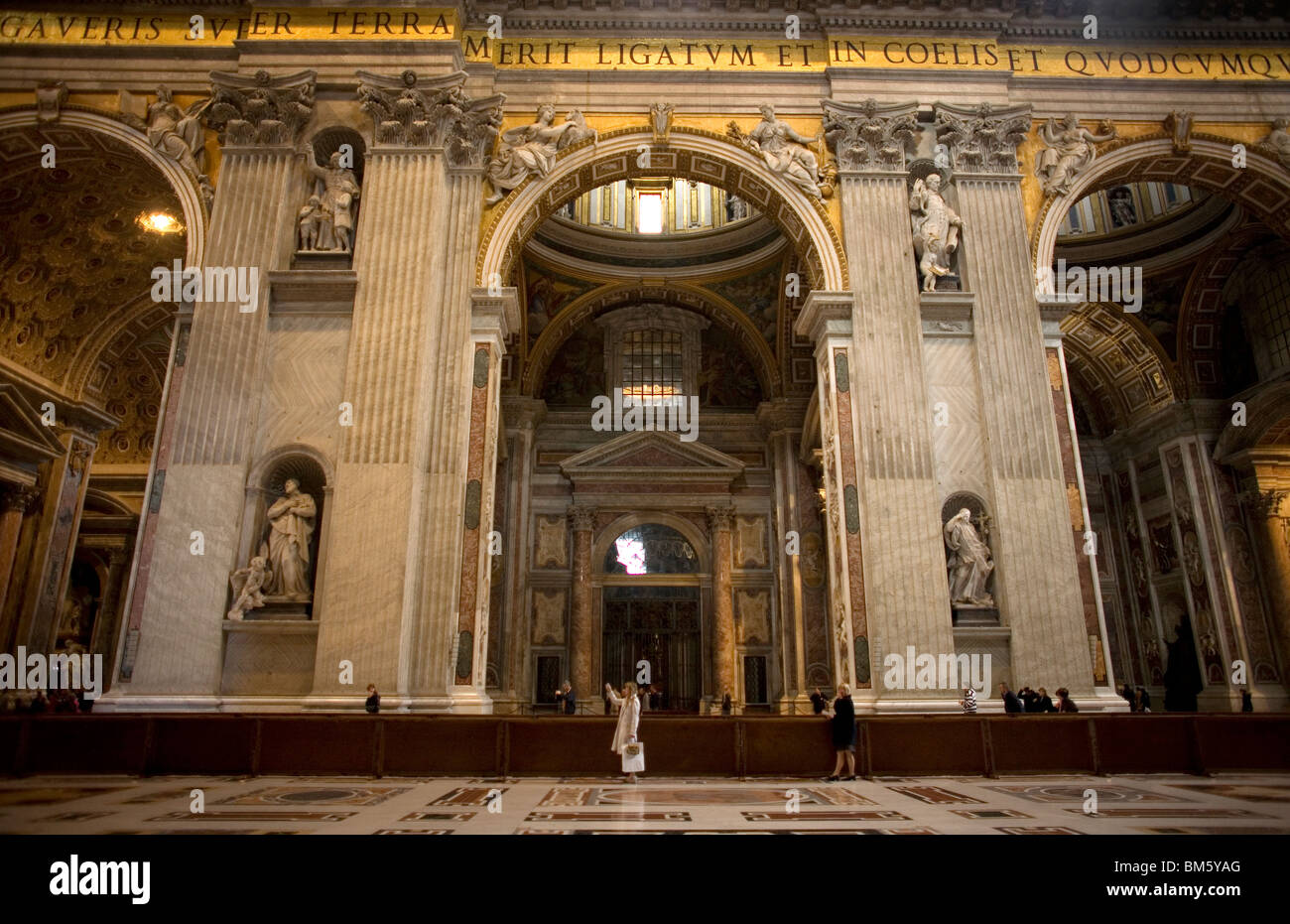 Tourists take pictures in St. Peter's Basilica in Vatican City, Rome, March 9, 2008. Photo/Chico Sanchez Stock Photo