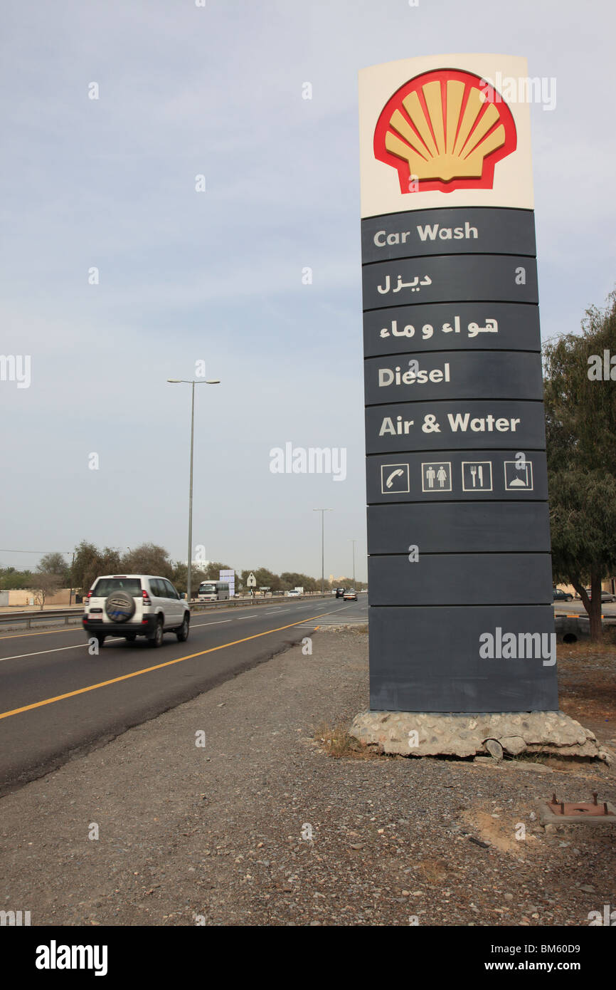 Bilingual Service Sign Of A Shell Gas Filling Station Near Muscat