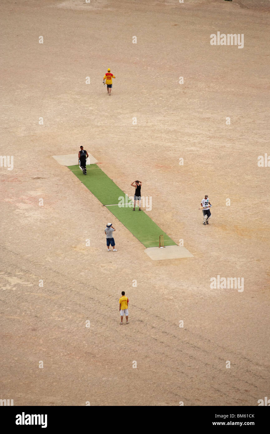 Playing Cricket on Historic Gravel Football and Cricket Oval, Queenstown, Western Tasmania, Australia - Stock Image