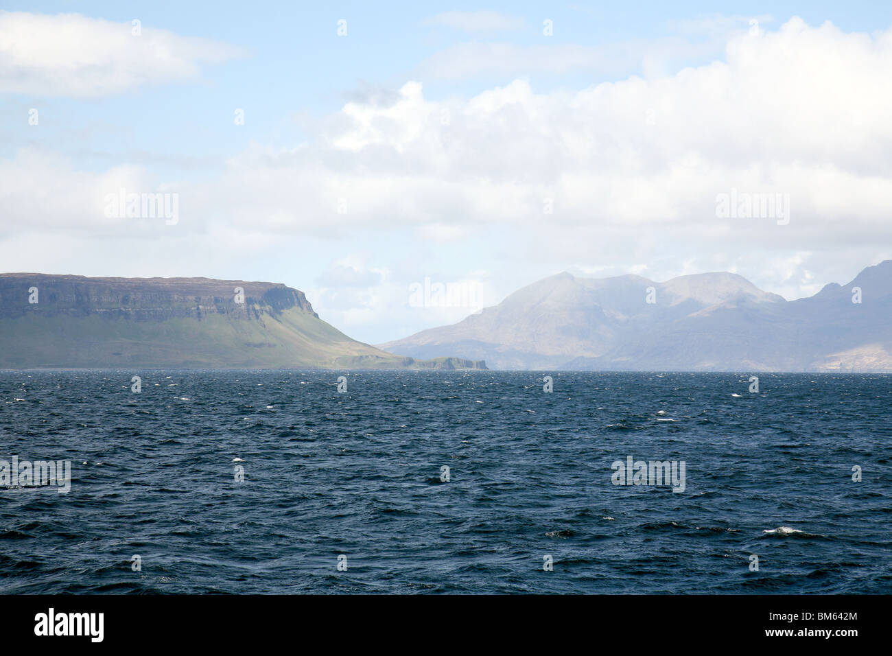 The islands of Eigg (to the left) and Rum (to the right), seen from the sea, The Western Isles, Scotland, UK - Stock Image