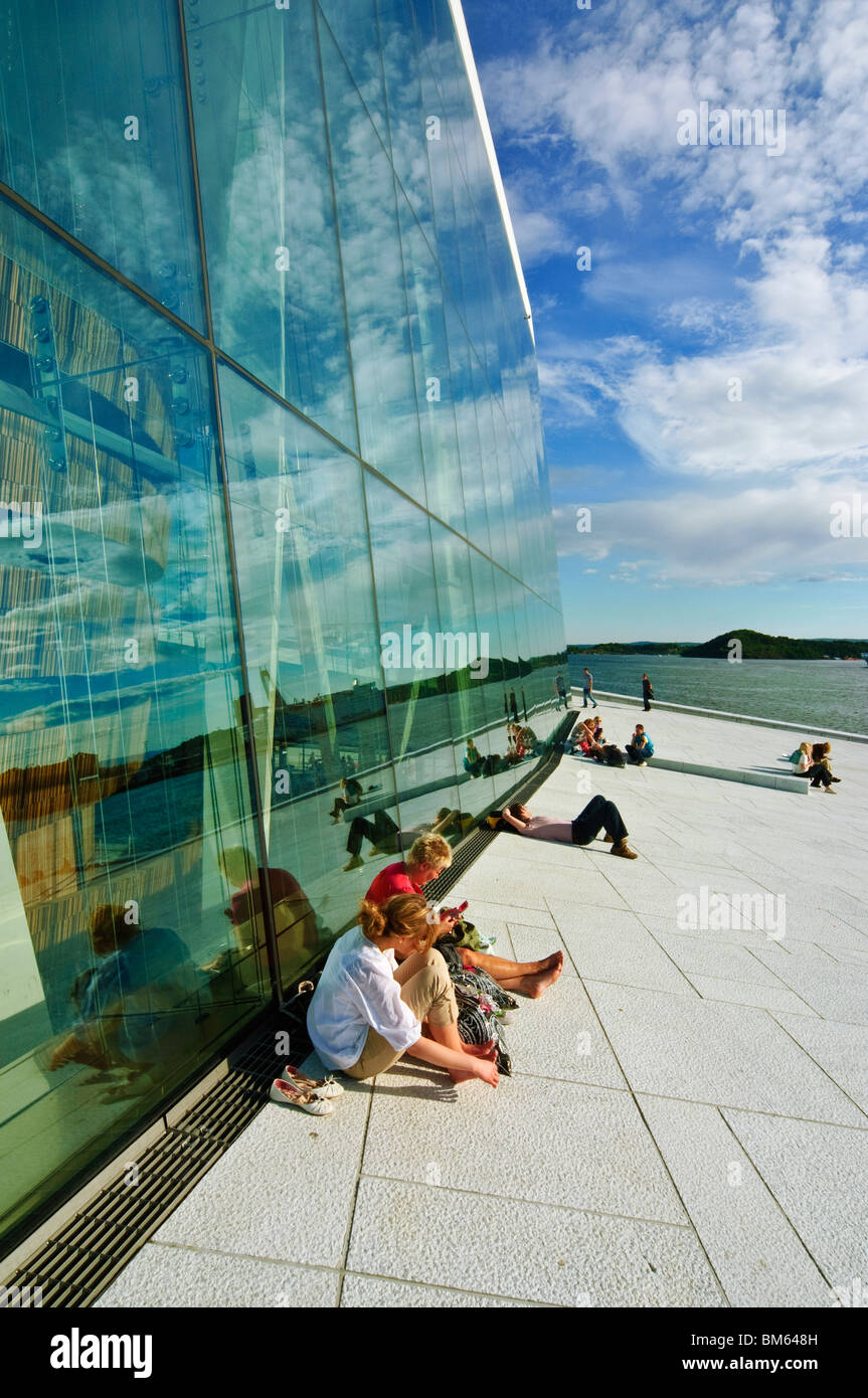 People relax outside Operaen the new Opera House (opened April 2008) in Oslo, Norway - Stock Image