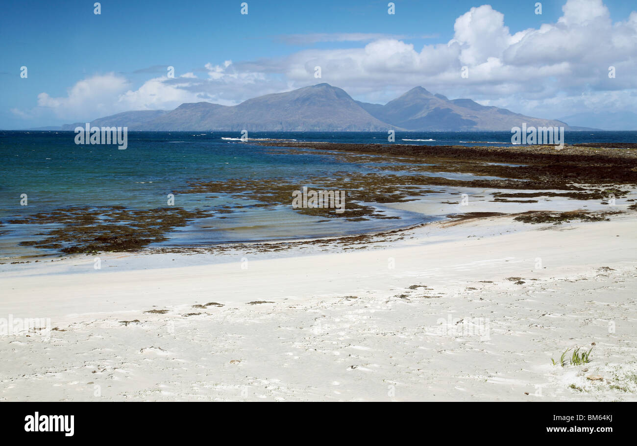 Beach on the Isle of Muck looking northwards towards the Isle of Rum, Western Isles, Scotland, UK - Stock Image