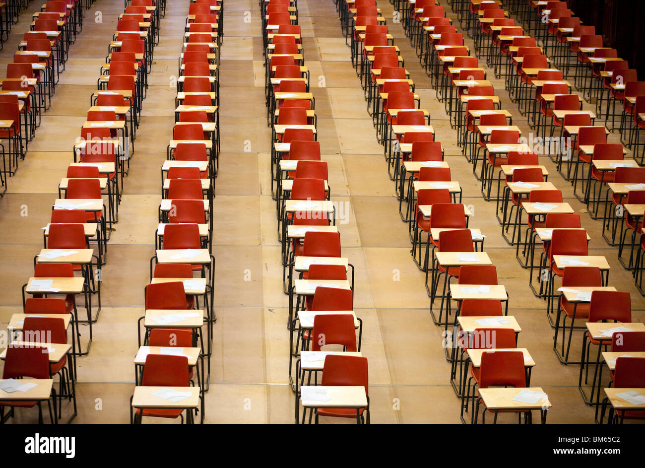 rows of chairs and tables set out in the great hall at Univeristy of Birmingham, England ready  for students to - Stock Image