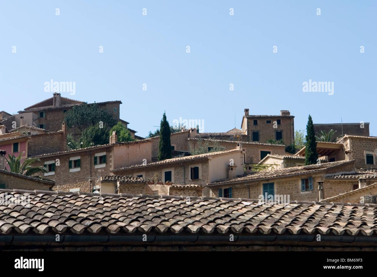 Single pitches of the house roofs of Deia (Majorca - Spain). Les toits à simple pente des maisons de Deia (Majorque - Stock Image