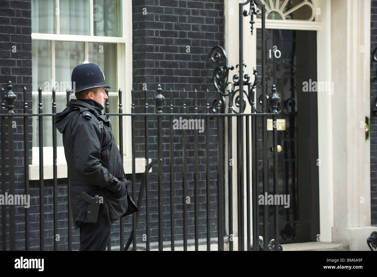 10 Downing Street, London. The official residence of the British Prime Minister, here with a policeman or 'Bobby' - Stock Image