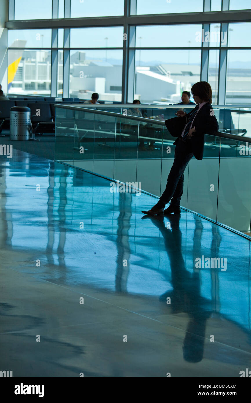 Stylish Young Japanese man in SFO Airport - Stock Image