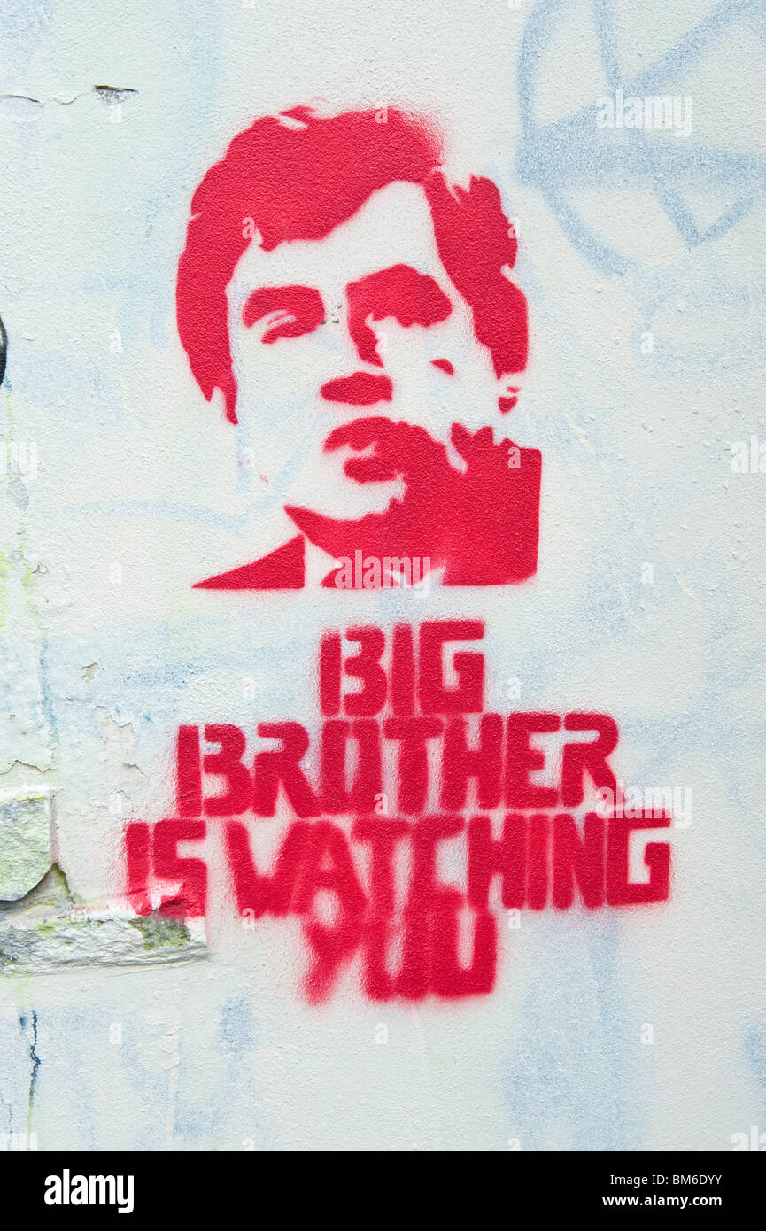 BIG BROTHER IS WATCHING YOU graffiti featuring Gordon Brown on white wall in Cardiff South Wales UK - Stock Image