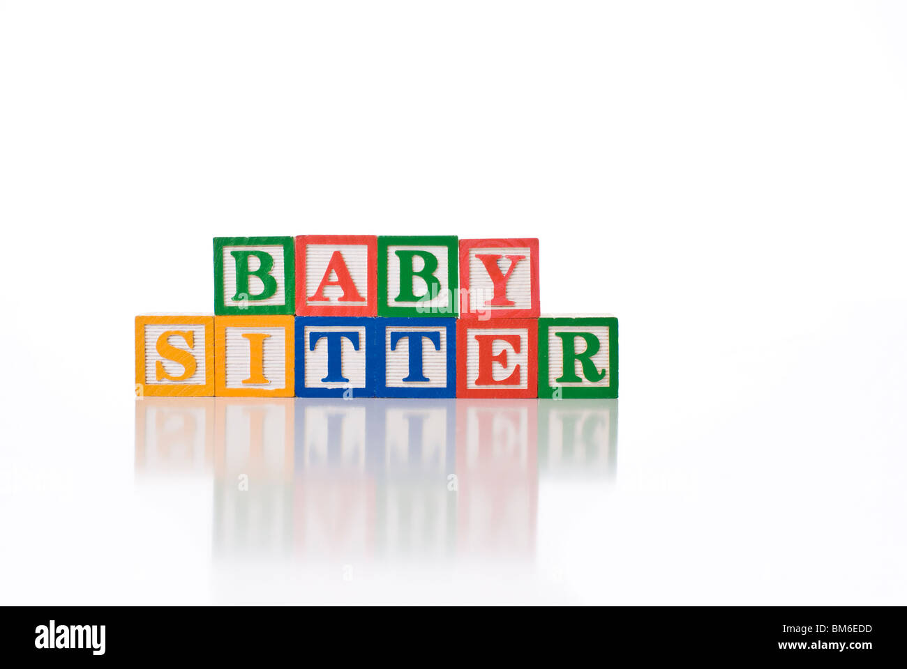 colorful childrens blocks spelling the words baby sitter