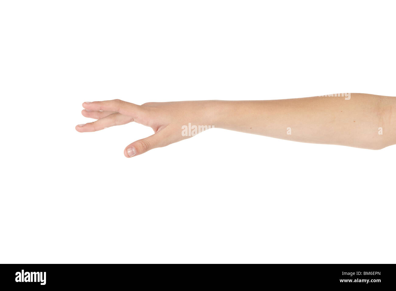 Caucasian belly dancing girl showing arm moves on white background. Not isolated - Stock Image