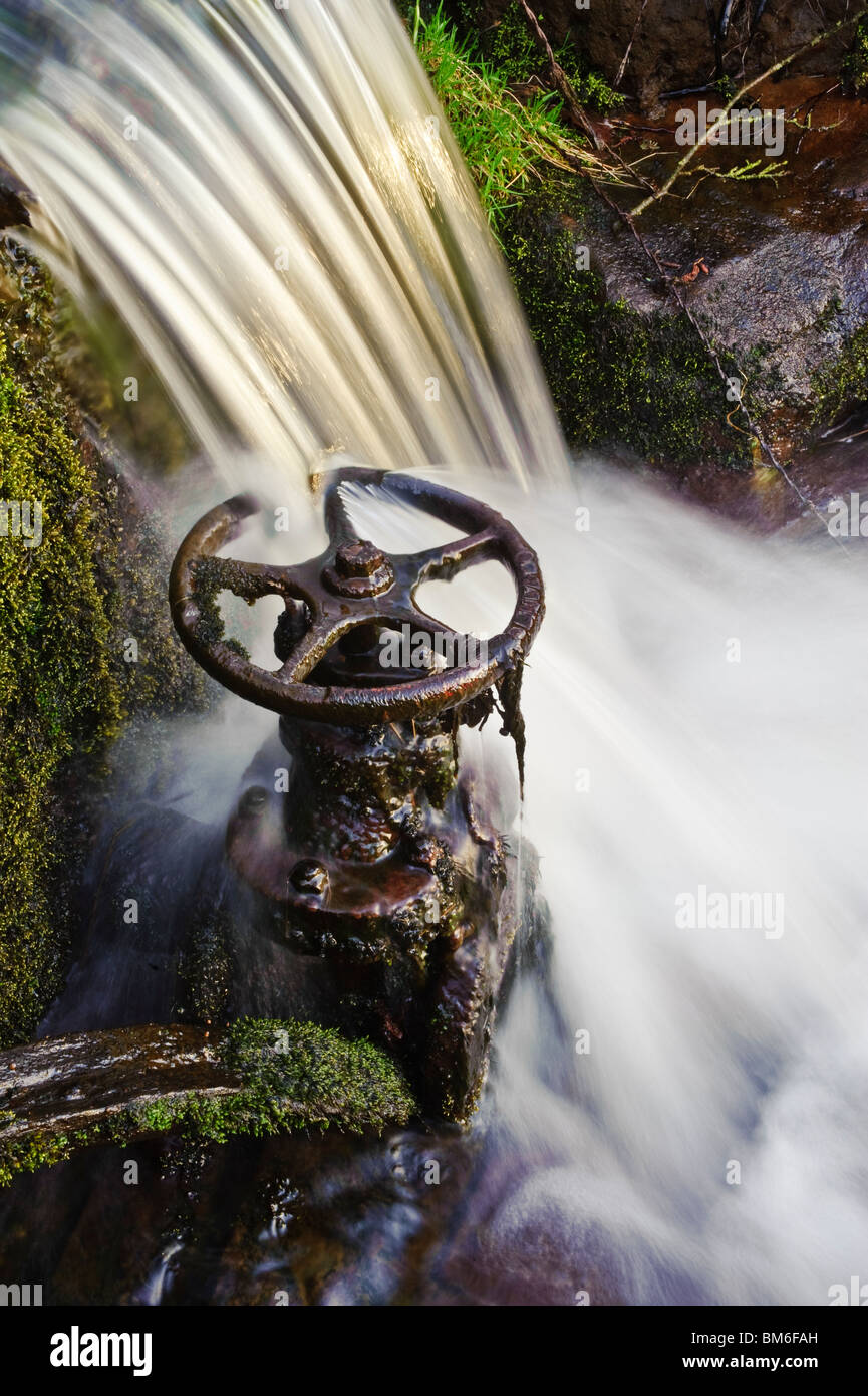 Waterfall and old sluice valve on mill stream Lancashire - Stock Image