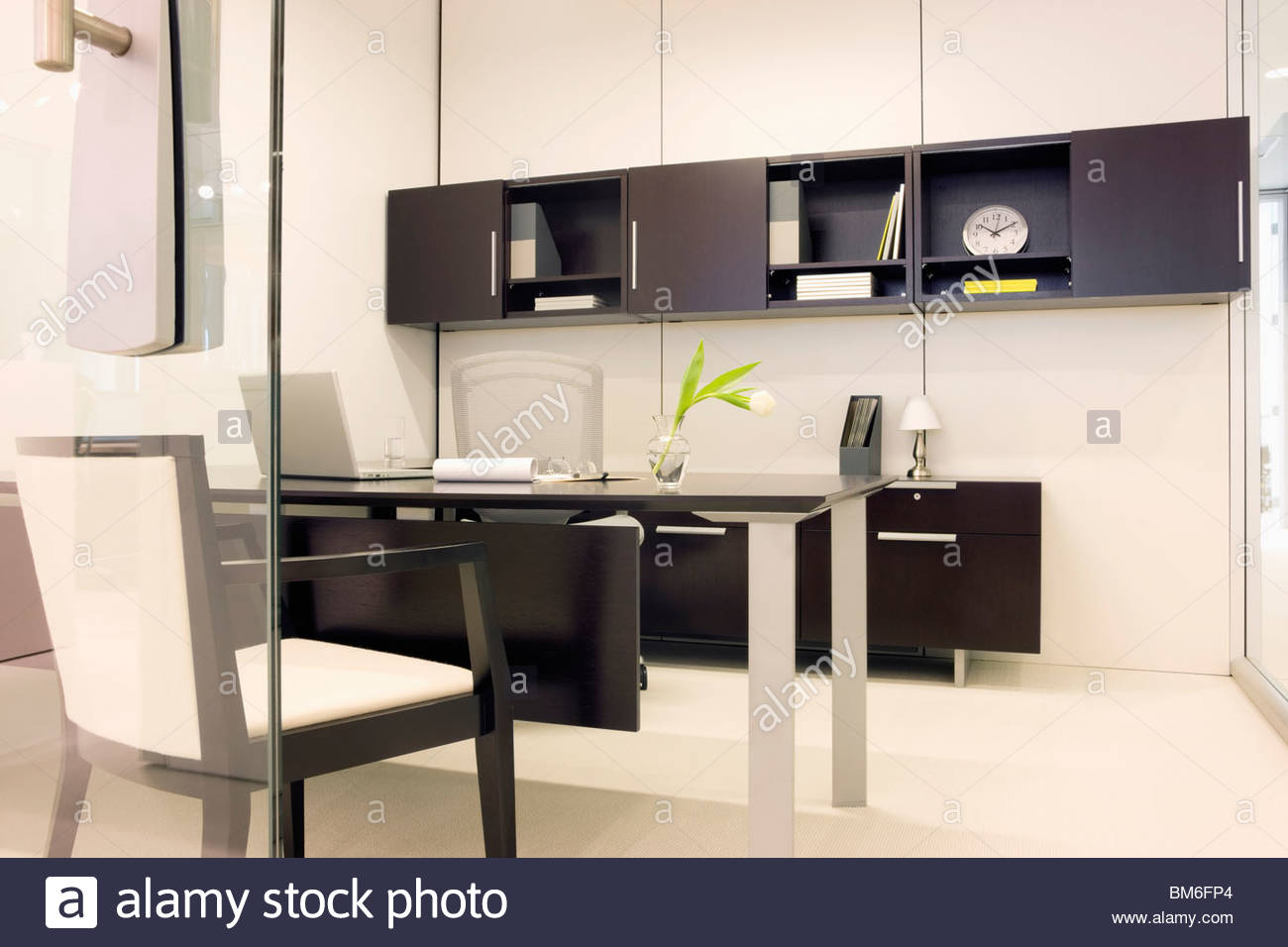 Empty modern office with glass walls - Stock Image