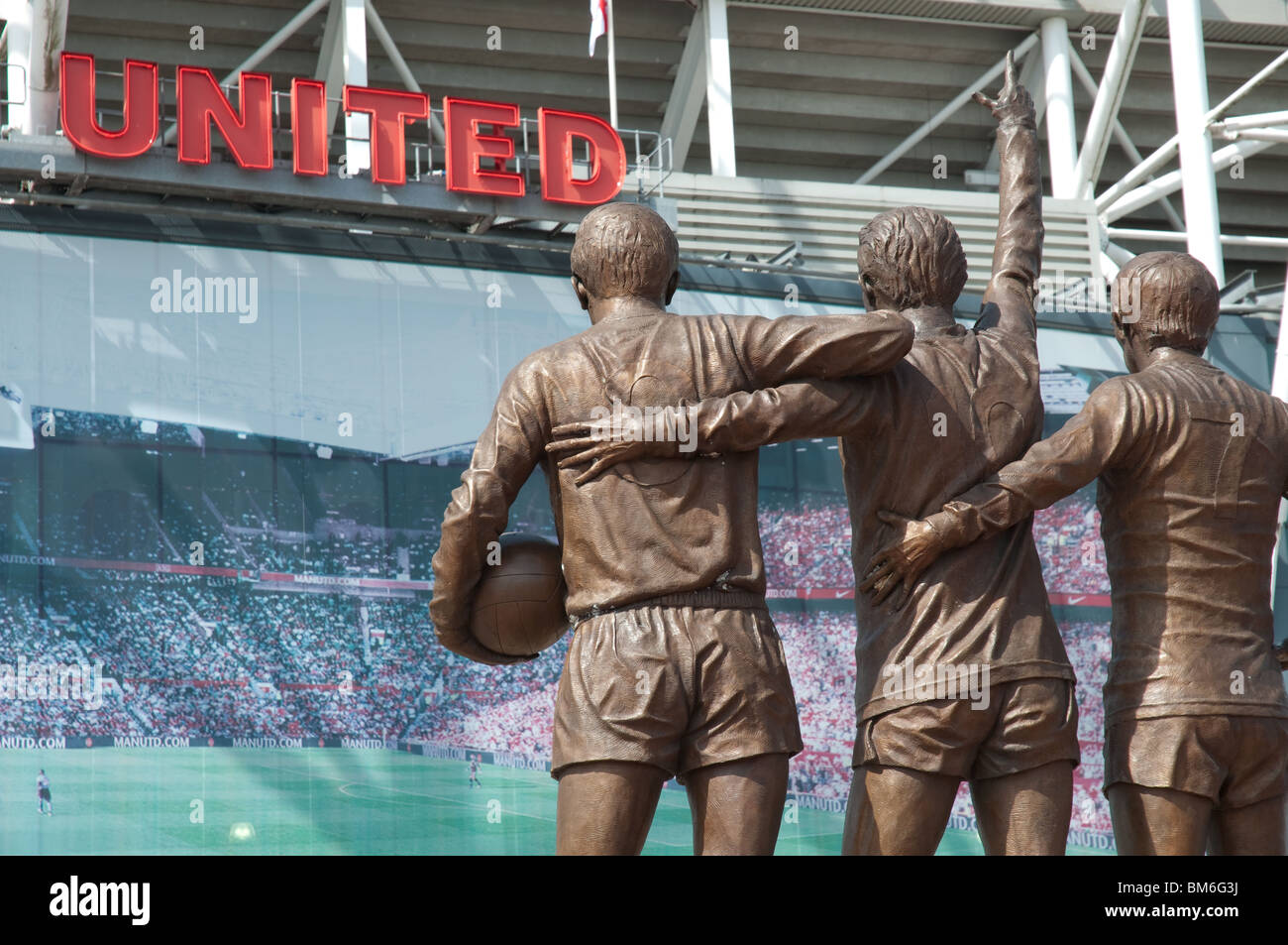 Manchester United, Holy Trinity statue at Old Trafford ,Manchester, England - Stock Image
