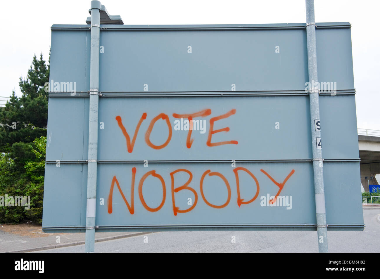 VOTE NOBODY graffiti on rear of roadsign in Cardiff South Wales UK - Stock Image