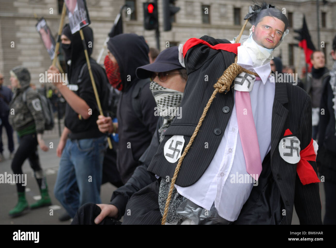 The effigy of BNP leader Nick Grriffin is dfragged through London to be hung on Parliament Square. - Stock Image