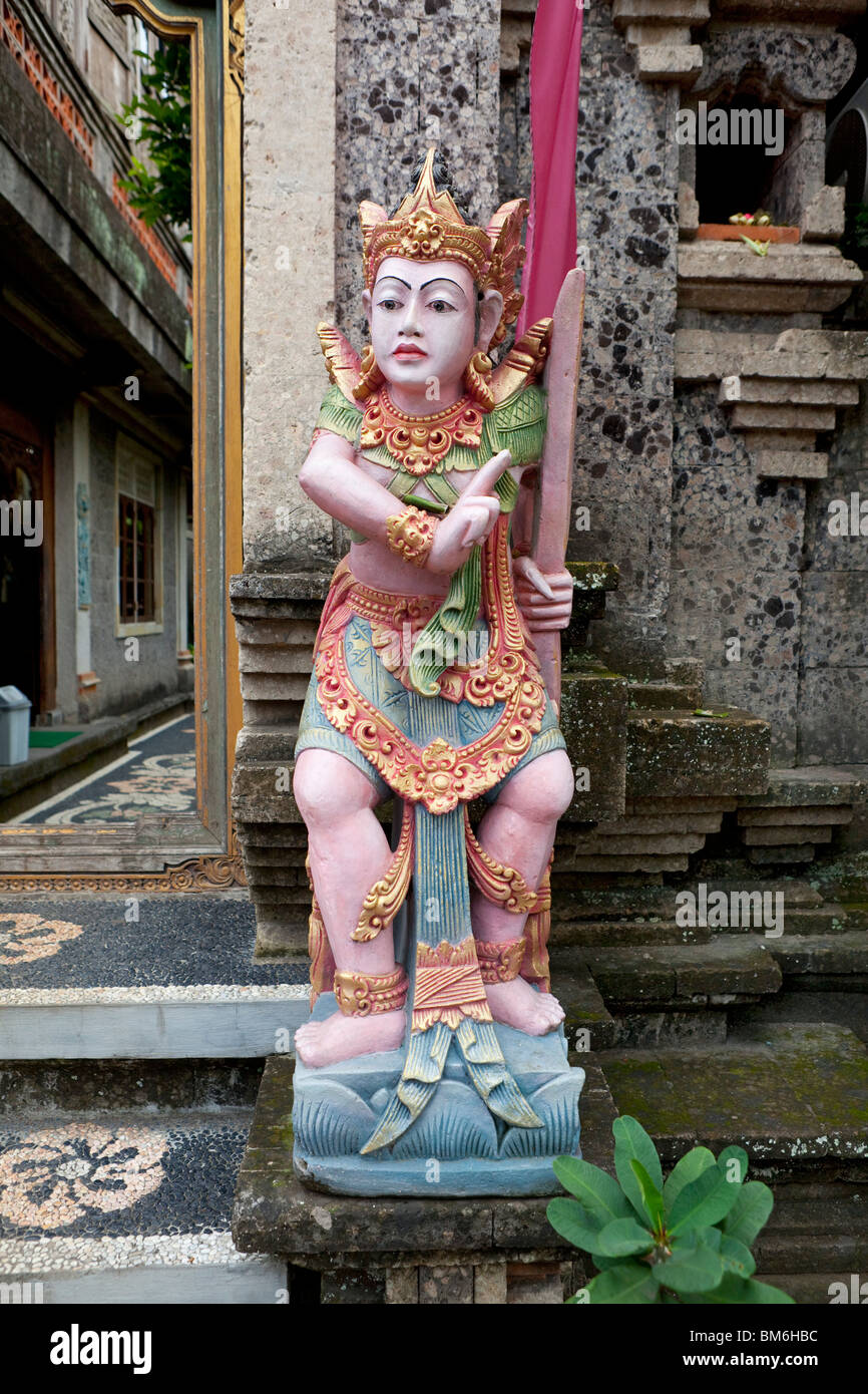 Painted statue at a house entrance in Bali, Indonesia - Stock Image
