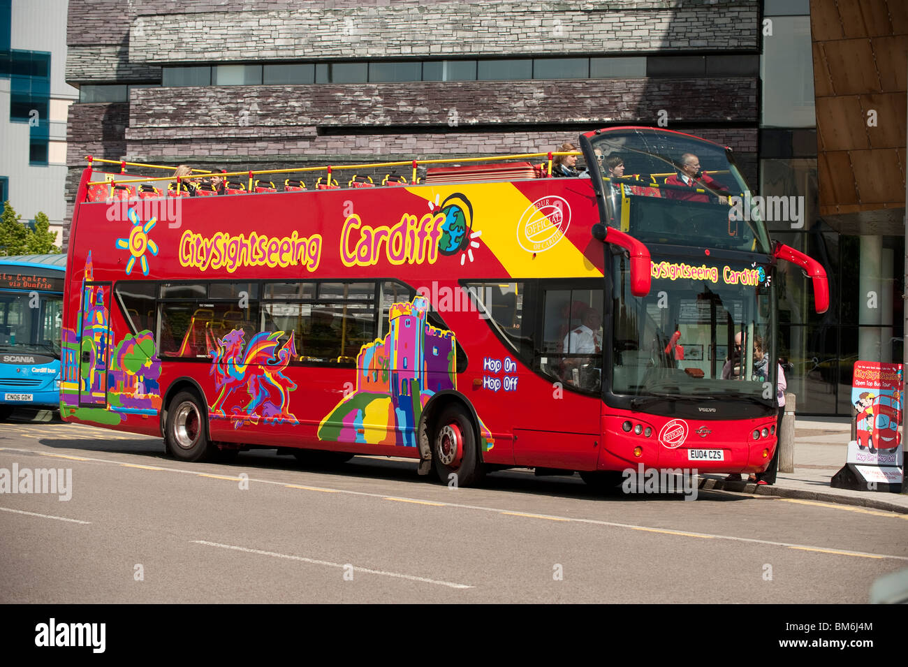 An open topped double decker sightseeing tour bus, Cardiff city, Wales UK - Stock Image