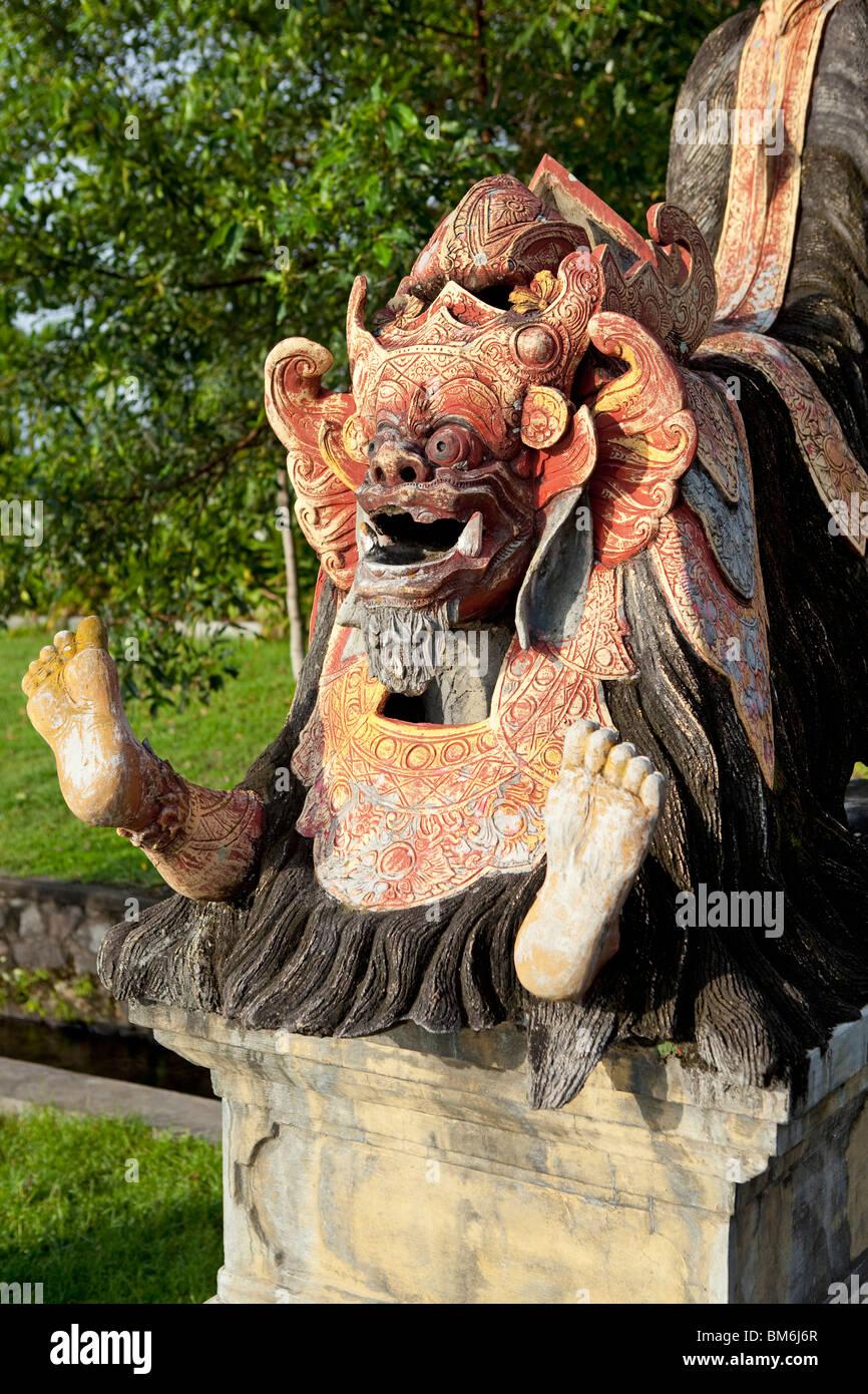 Painted statue at Taman Tirta Gangga Water Palace Bali Indonesia - Stock Image