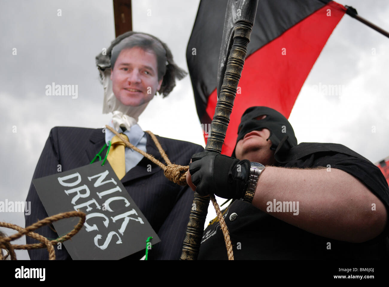 The effigy of Liberal Democrat leader Nick Clegg about to be hung by the executioner on Parliament Square on May - Stock Image