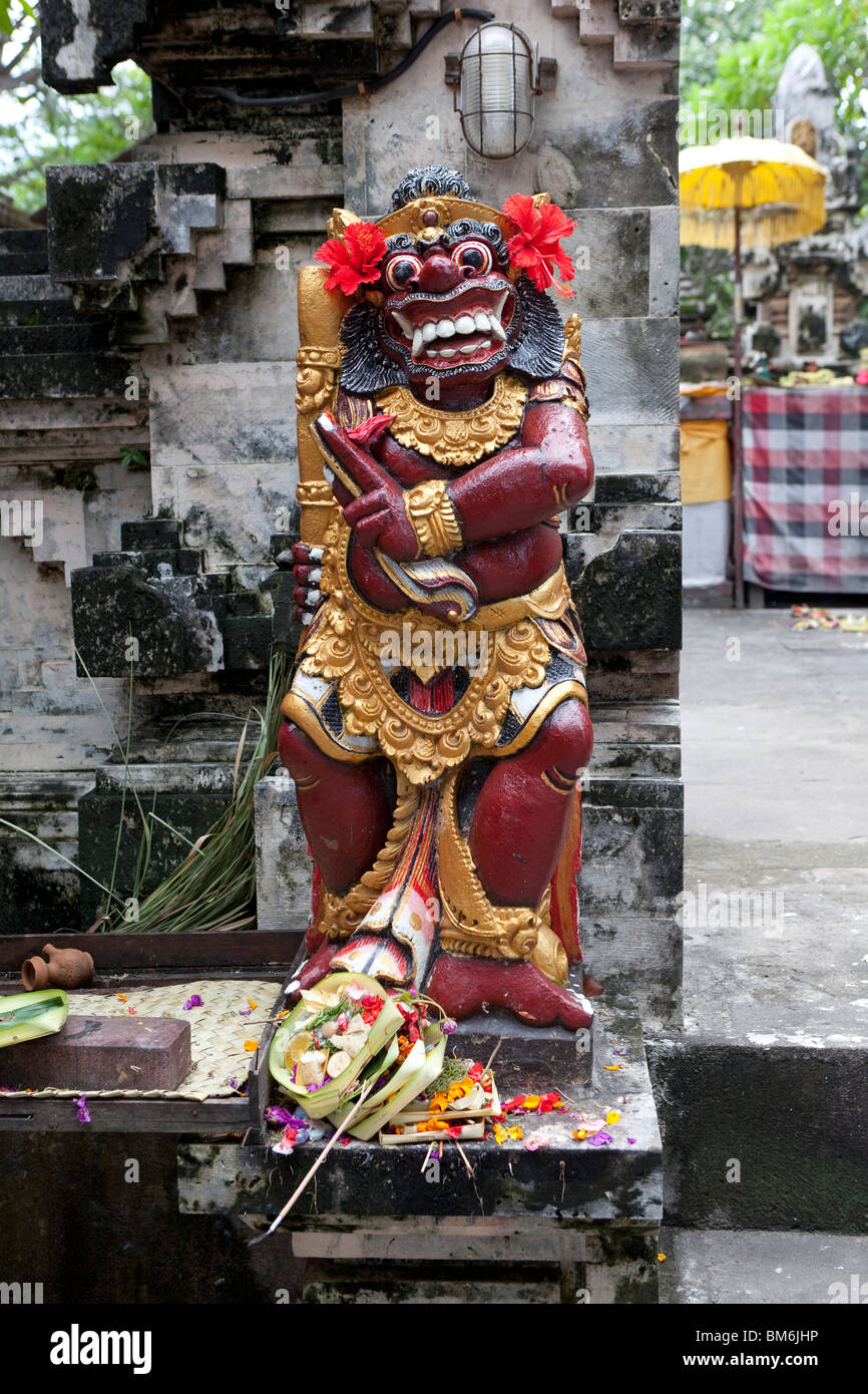 Painted statue at a temple entrance in Bali, Indonesia - Stock Image