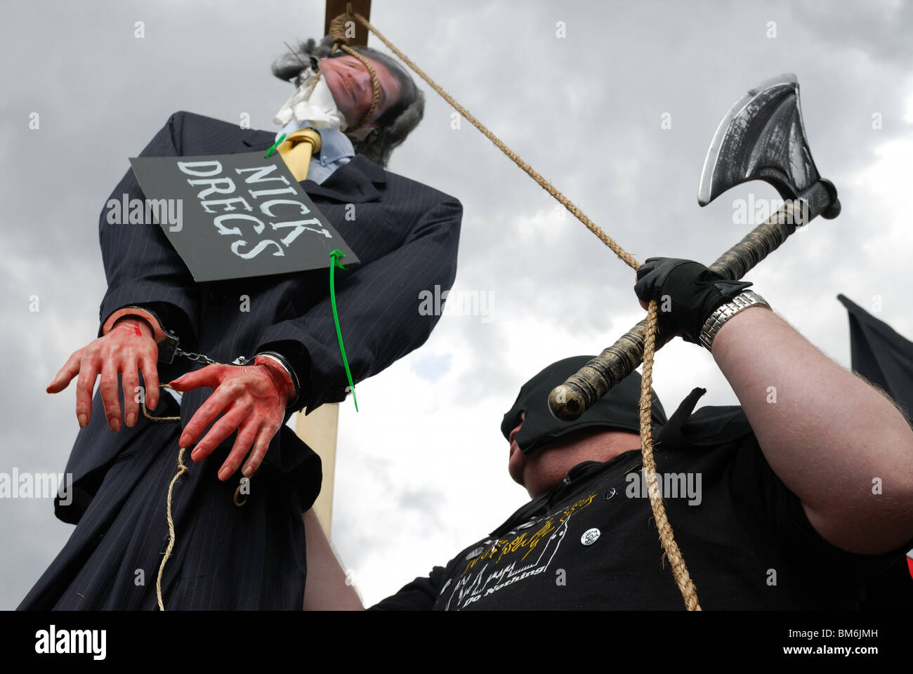 The effigy of Liberal Democrat leader Nick Clegg being hung by the executioner on Parliament Square on May Day. - Stock Image
