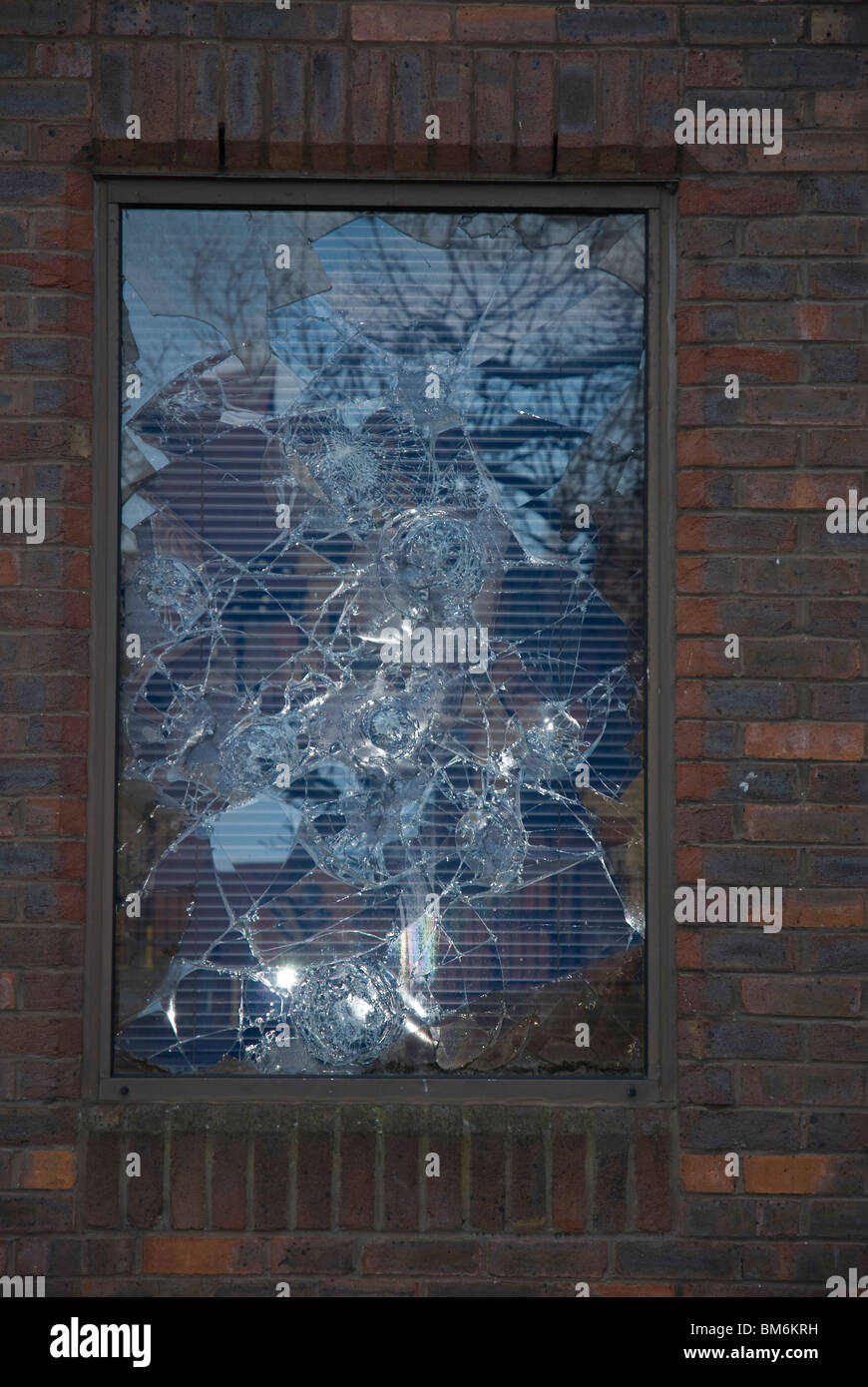 Broken window in a disused building Isleworth, West London England UK - Stock Image