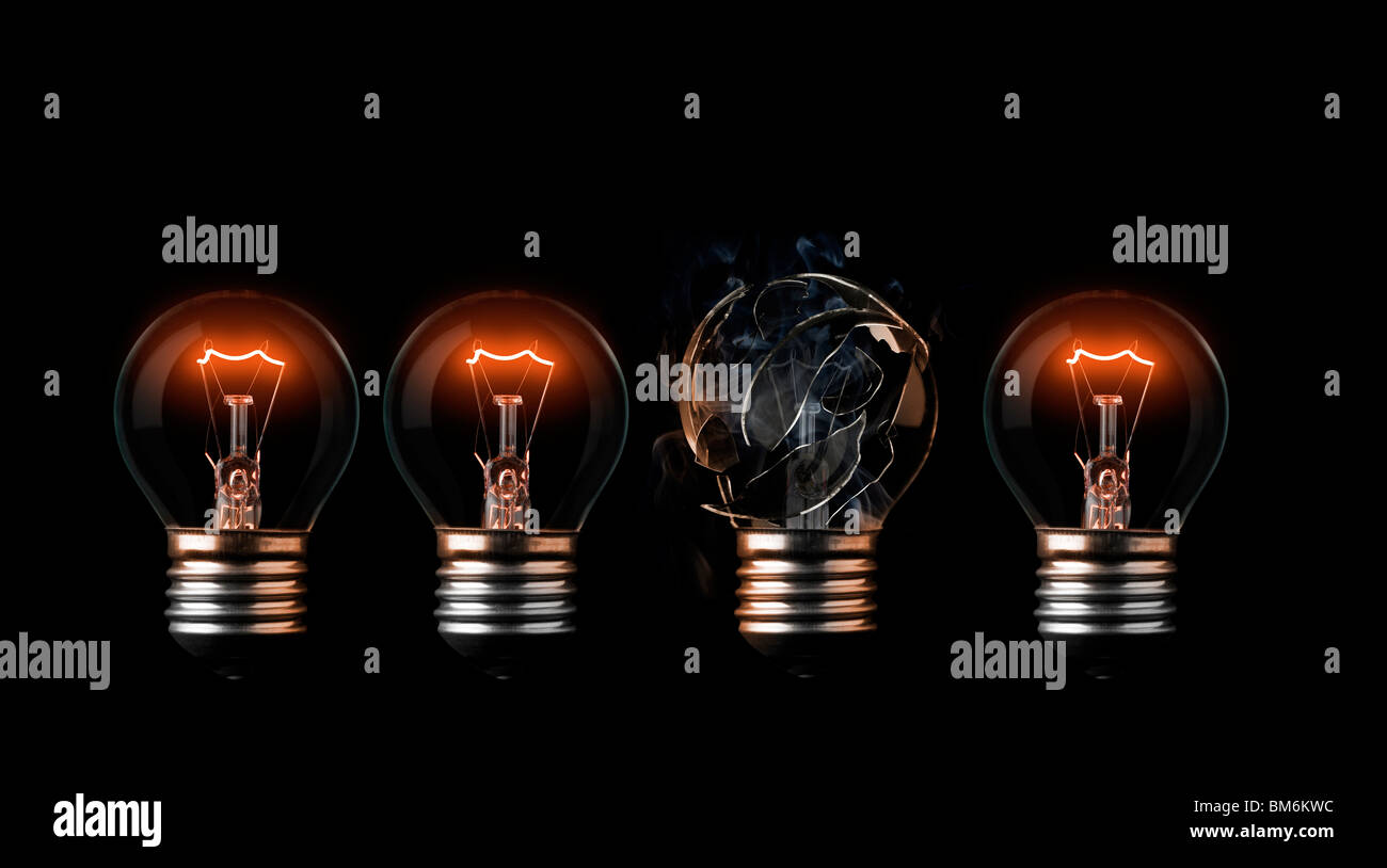 One burn out light bulb in a row of good ones - Stock Image