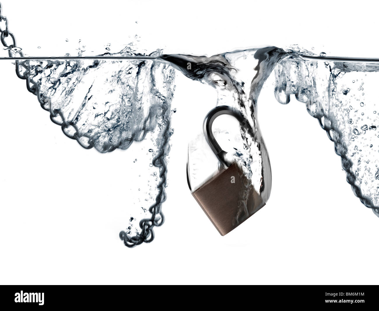 padlock and chains falling into water - Stock Image