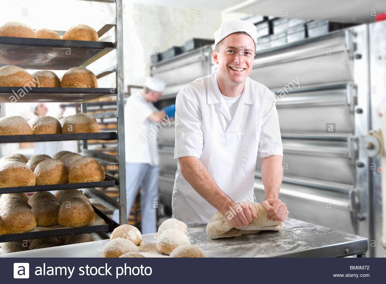 Baker Kneading Bread Dough In Bakery Stock Photo 29651078