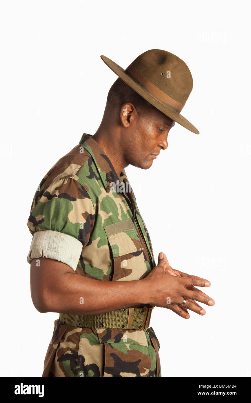 A Military Man With His Head Bowed In Contemplation - Stock Image