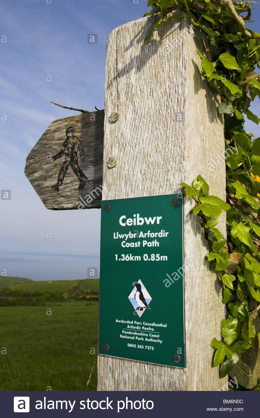 Llwybr Arfordir footpath signpost for Ceibwr Bay near Moylegrove in Pembrokeshire, west Wales, UK. - Stock Image