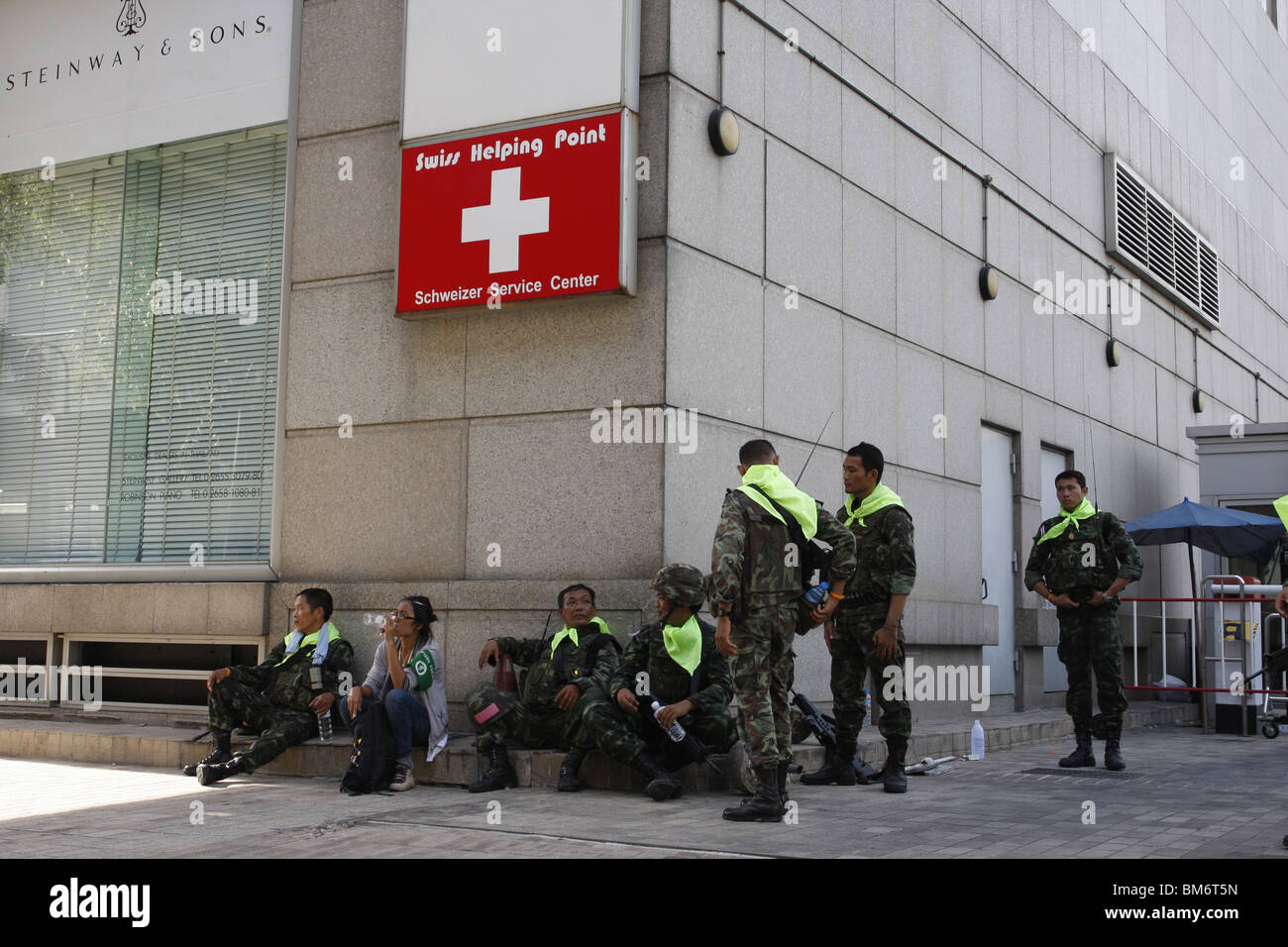 On May 19th, Thai soldiers rest in Chit Lom during a military assault on Red Shirt demonstrators Stock Photo