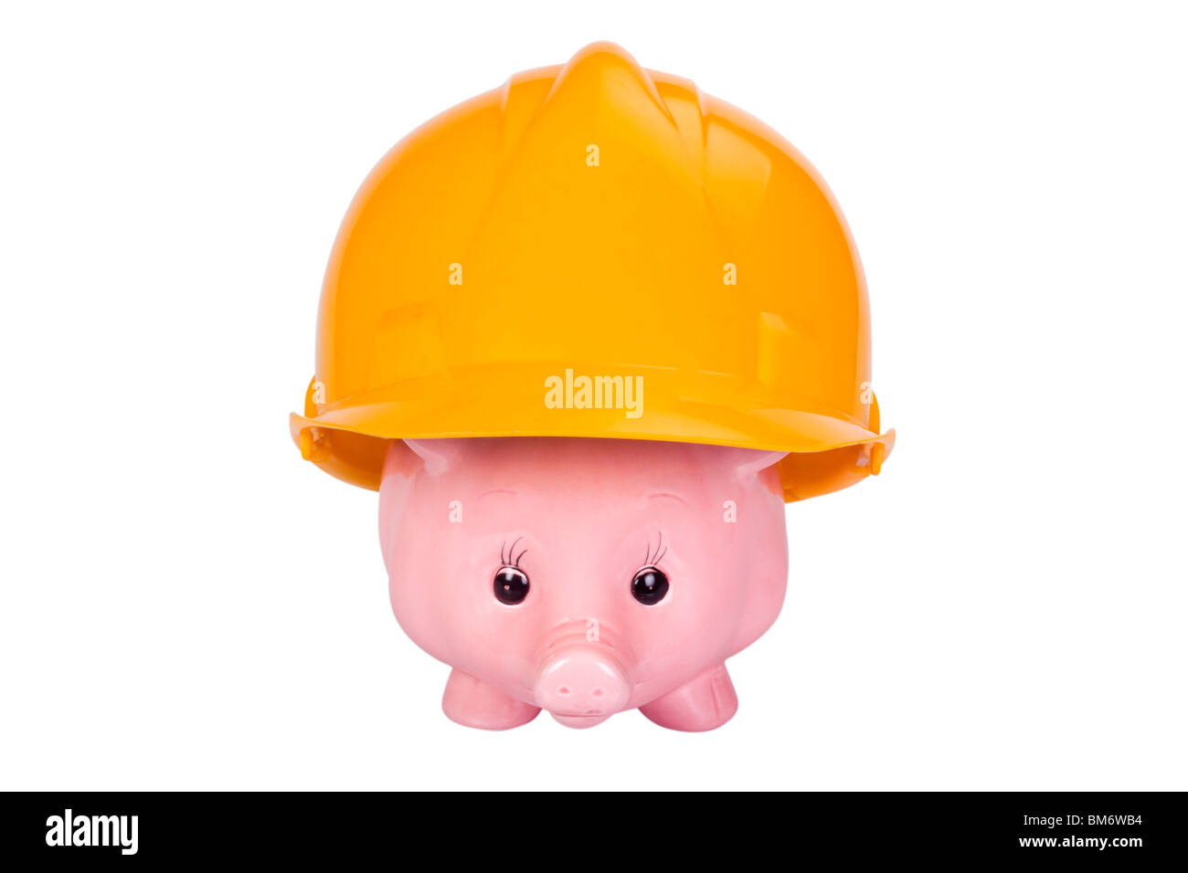 Close-up of a piggy bank with a hardhat - Stock Image