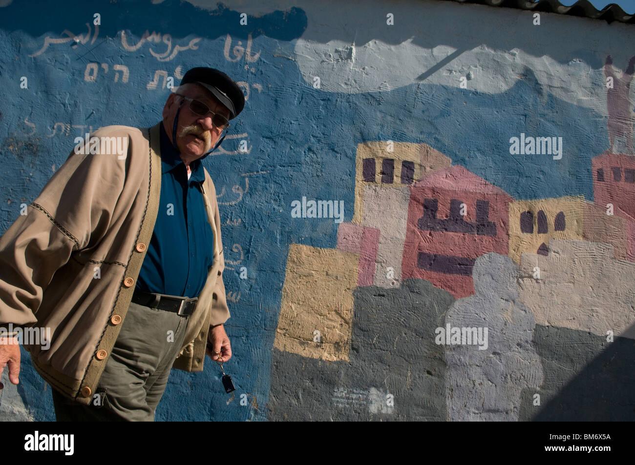 A pedestrian pass graffiti wall in Ajami a mixed Arab Jewish neighborhood south of Tel Aviv Israel - Stock Image