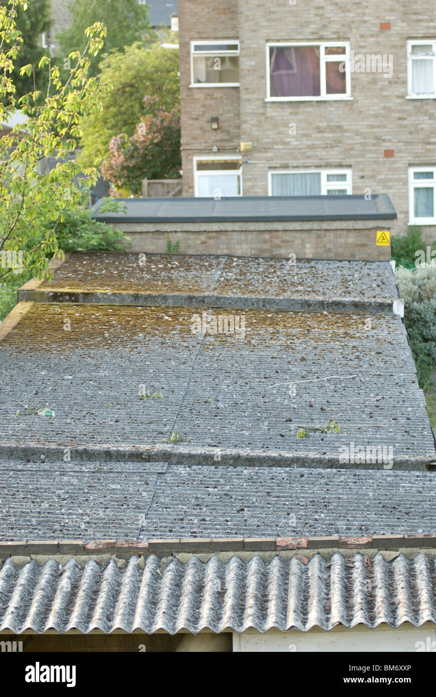 corrugated garage roof tops made from asbestos - Stock Image
