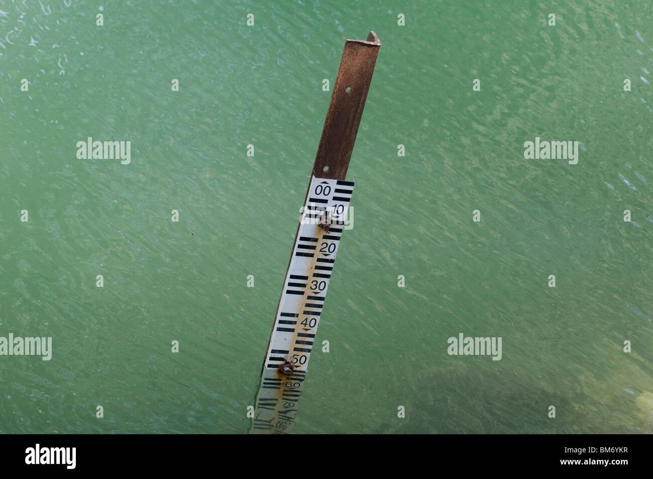 Water level gauge indicators at the Jordan river close to the lake Kineret Galilee Northern Israel - Stock Image
