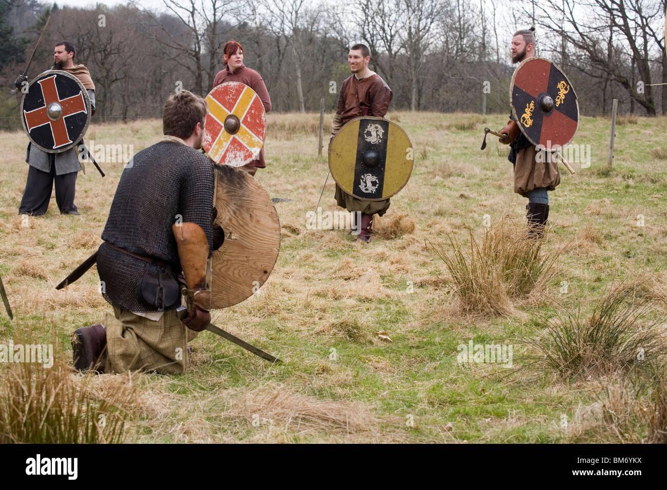 Reenactment. Viking Warriors preparing for battle. Ale Viking Village, Sweden - Stock Image