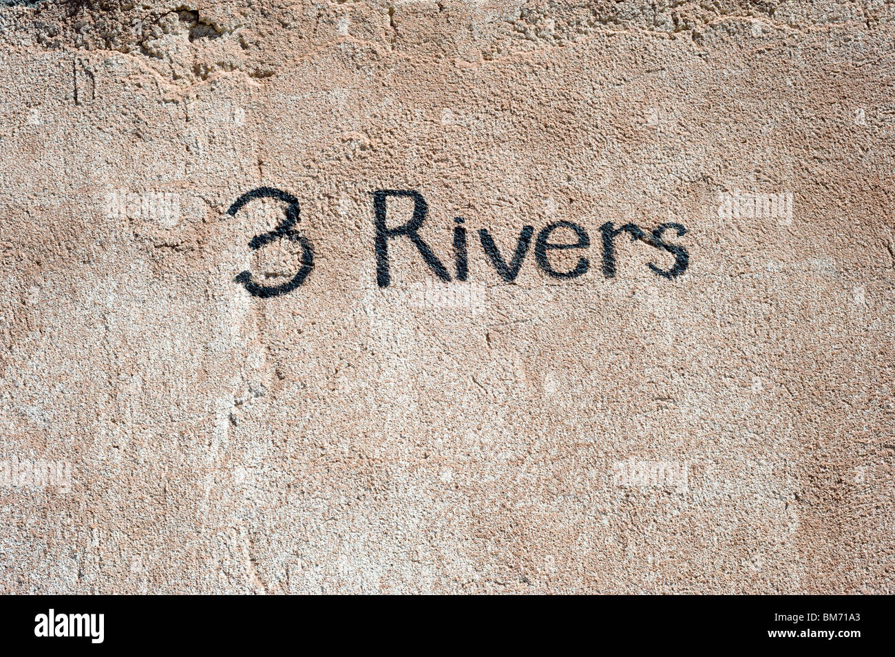 The name of the vanished town is painted on an old adobe wall, at Three Rivers, New Mexico. - Stock Image