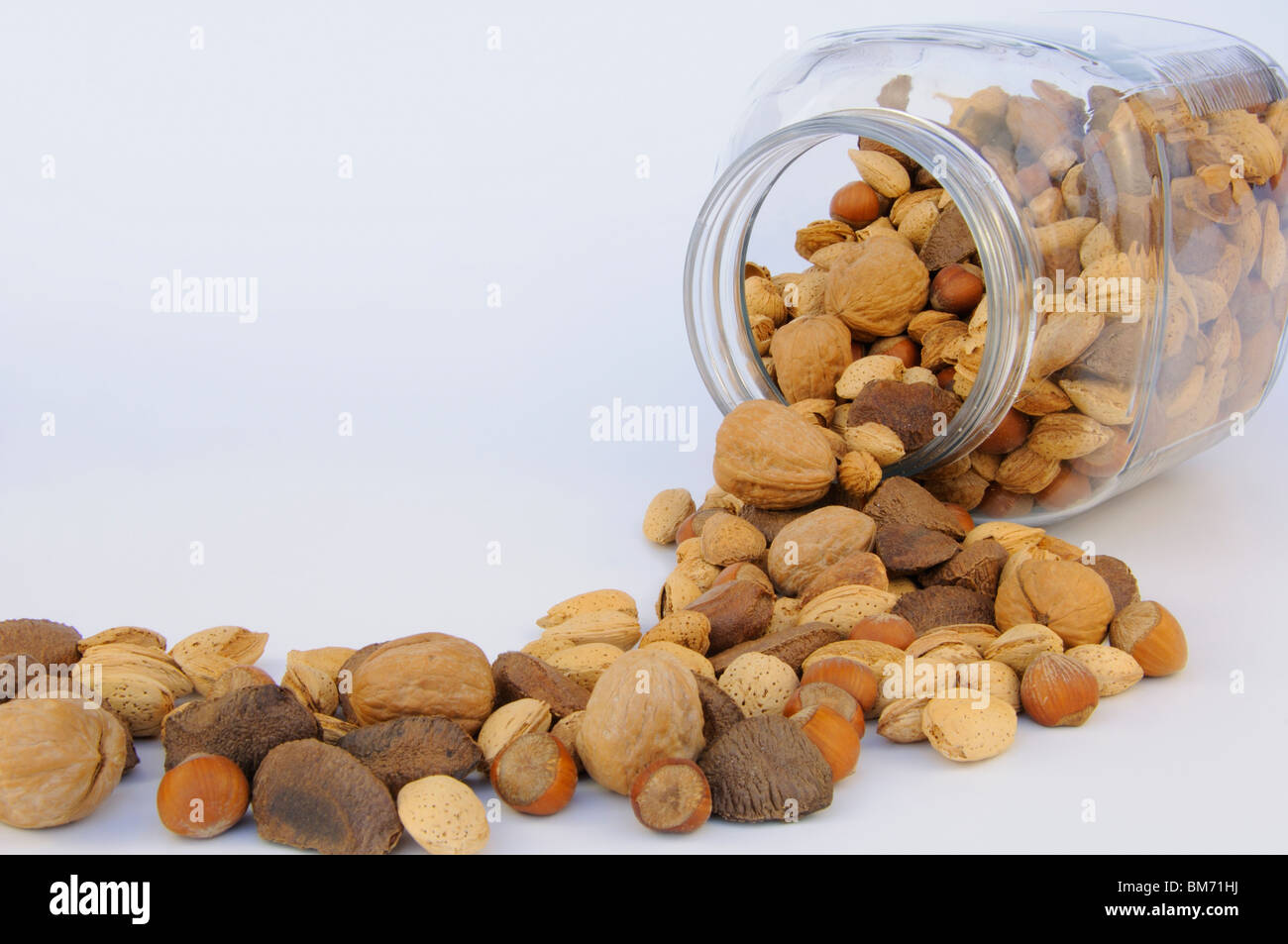 Mixed nuts in shells - Stock Image