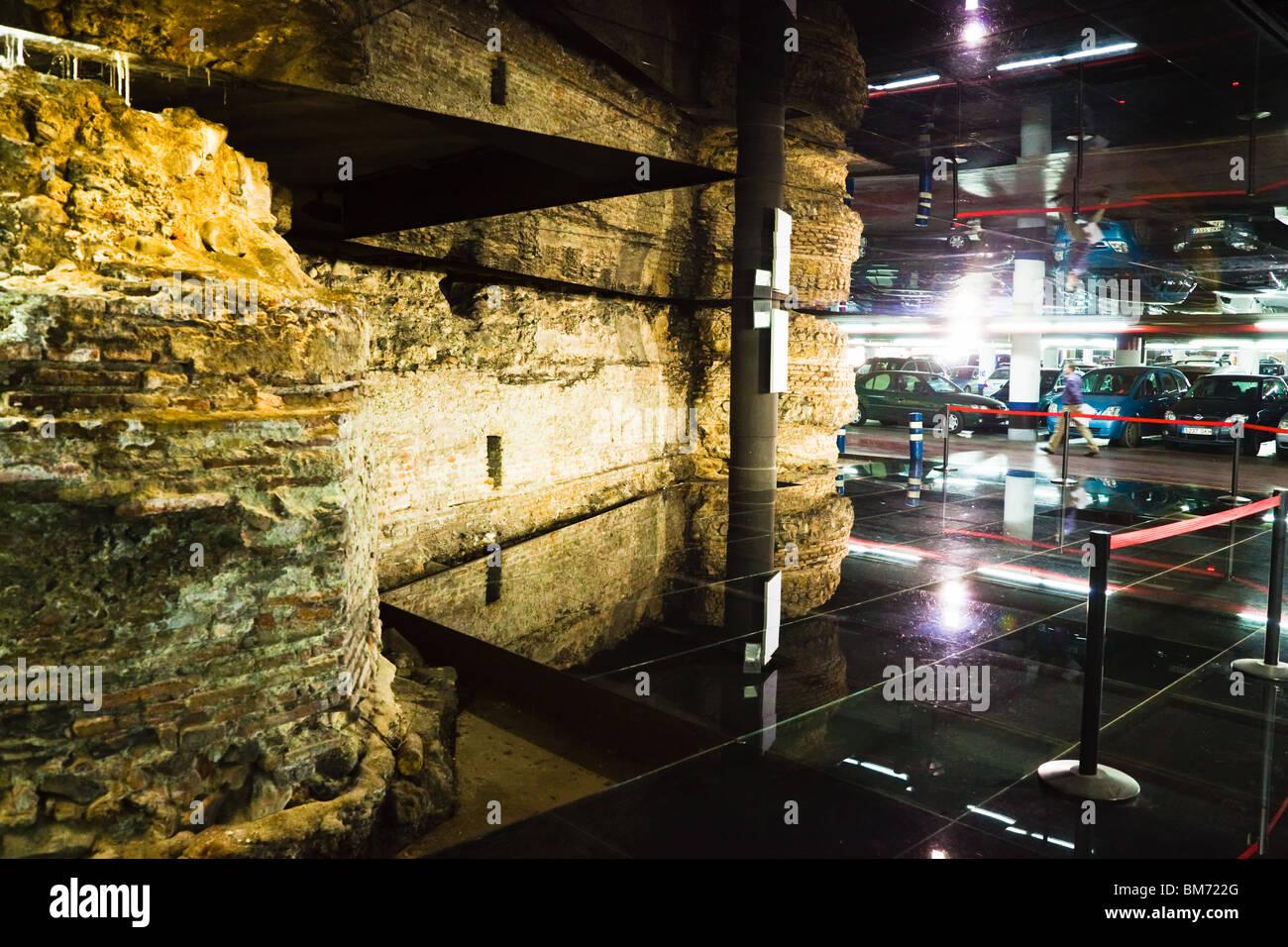 Malaga, Malaga Province, Costa del Sol, Spain. Ancient city walls in parking garage beneath Plaza de la Marina - Stock Image