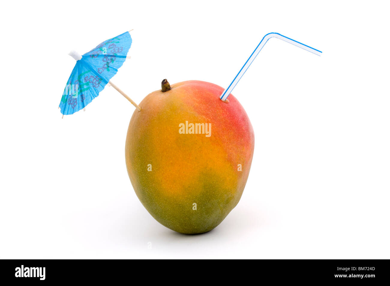 ripe mango with straw and umbrella on a white background - Stock Image