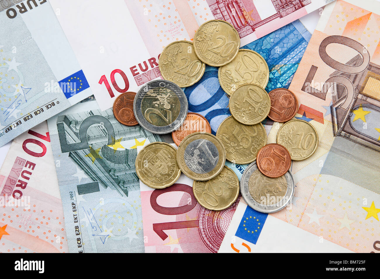 Euro notes and coins in various denominations from the European Union. Europe. - Stock Image