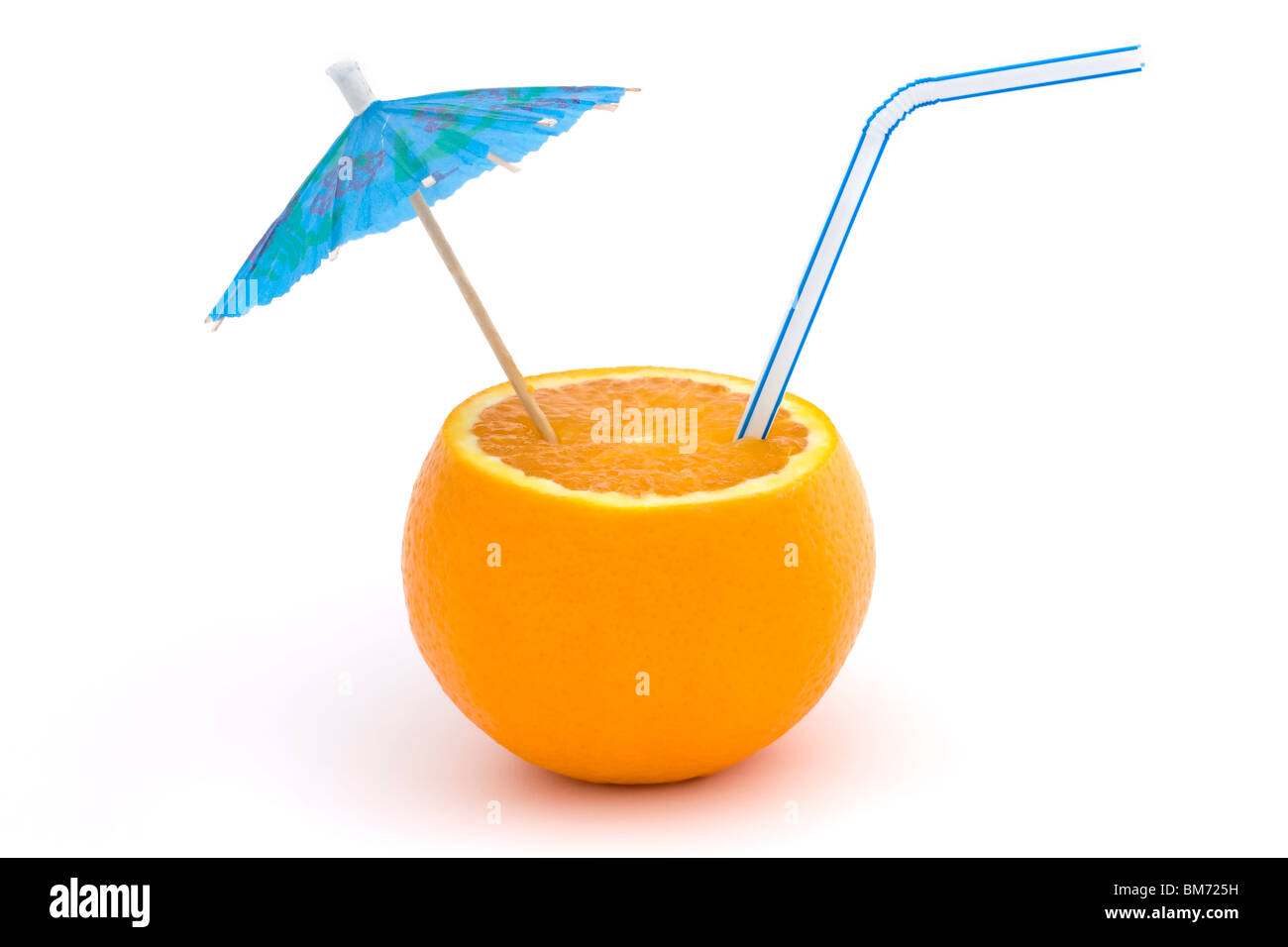orange with straw and blue umbrella on a white background - Stock Image