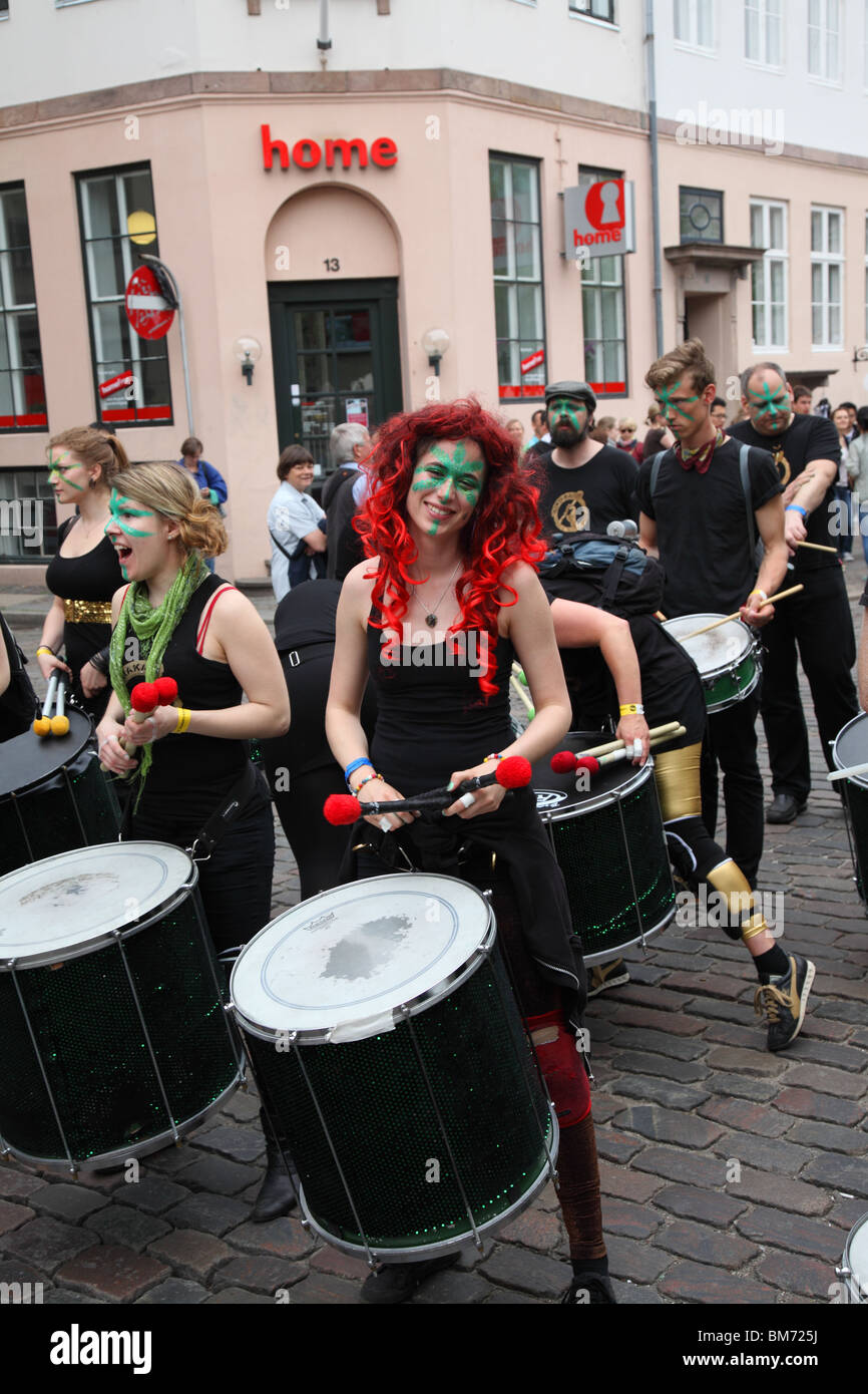 Whitsun or Pentecost samba carnival procession in the start of the parade on Strøget in Copenahgen - May 22, - Stock Image