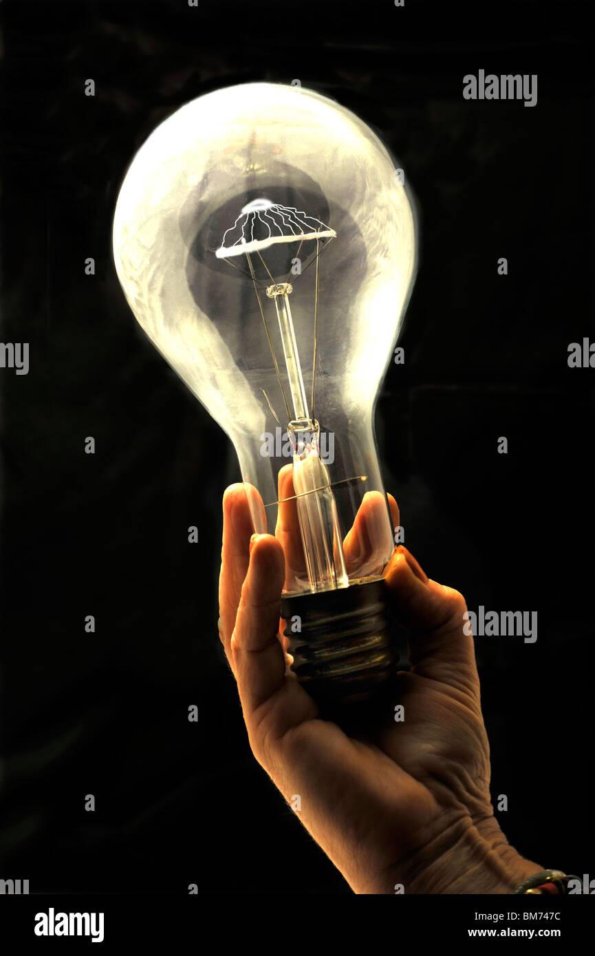 Light bulb in hand - Stock Image