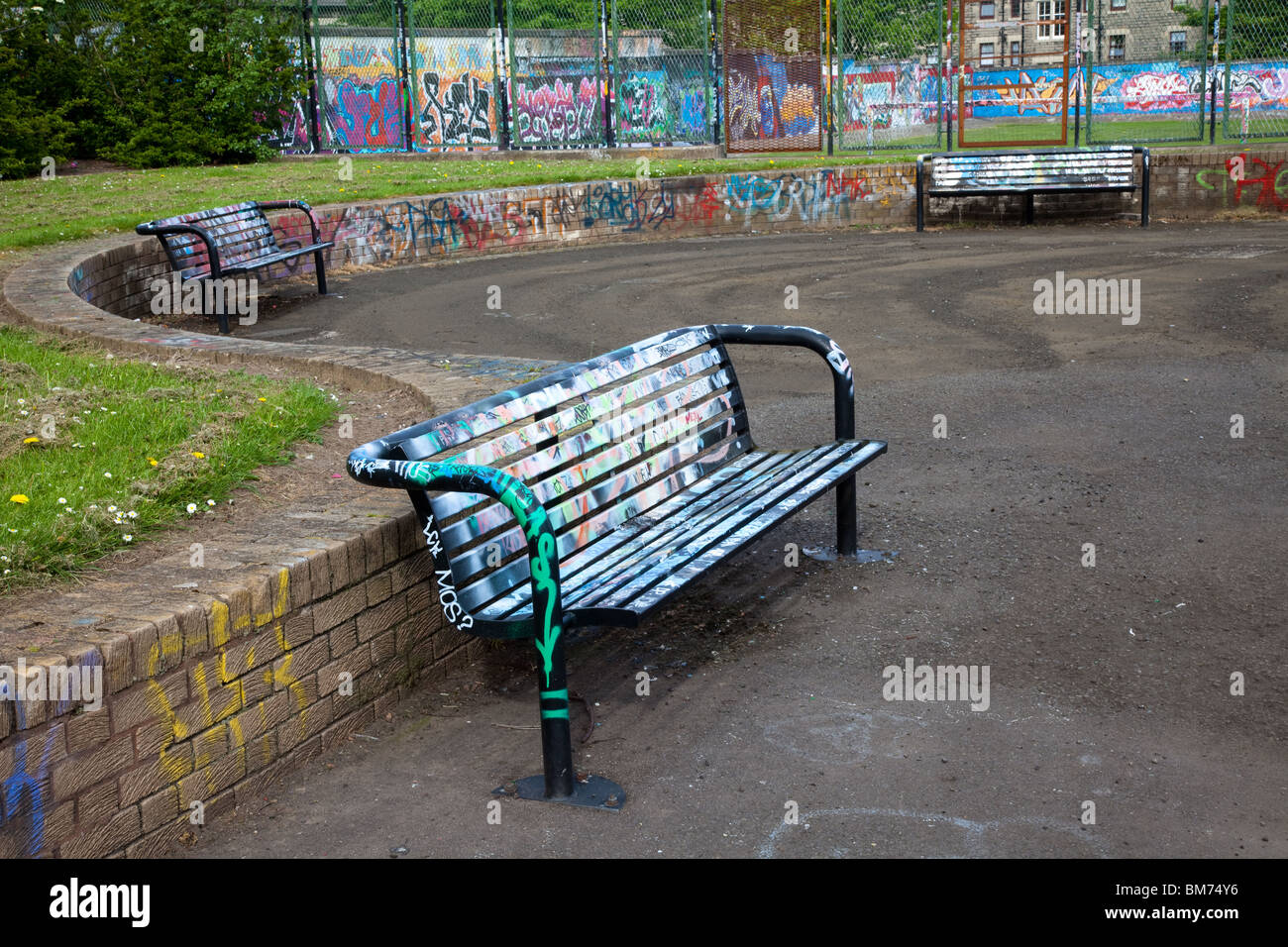 Legal graffiti wall and Metal framed bench around mains road, Hilltown Dundee, Dundee City, Scotland, UK - Stock Image
