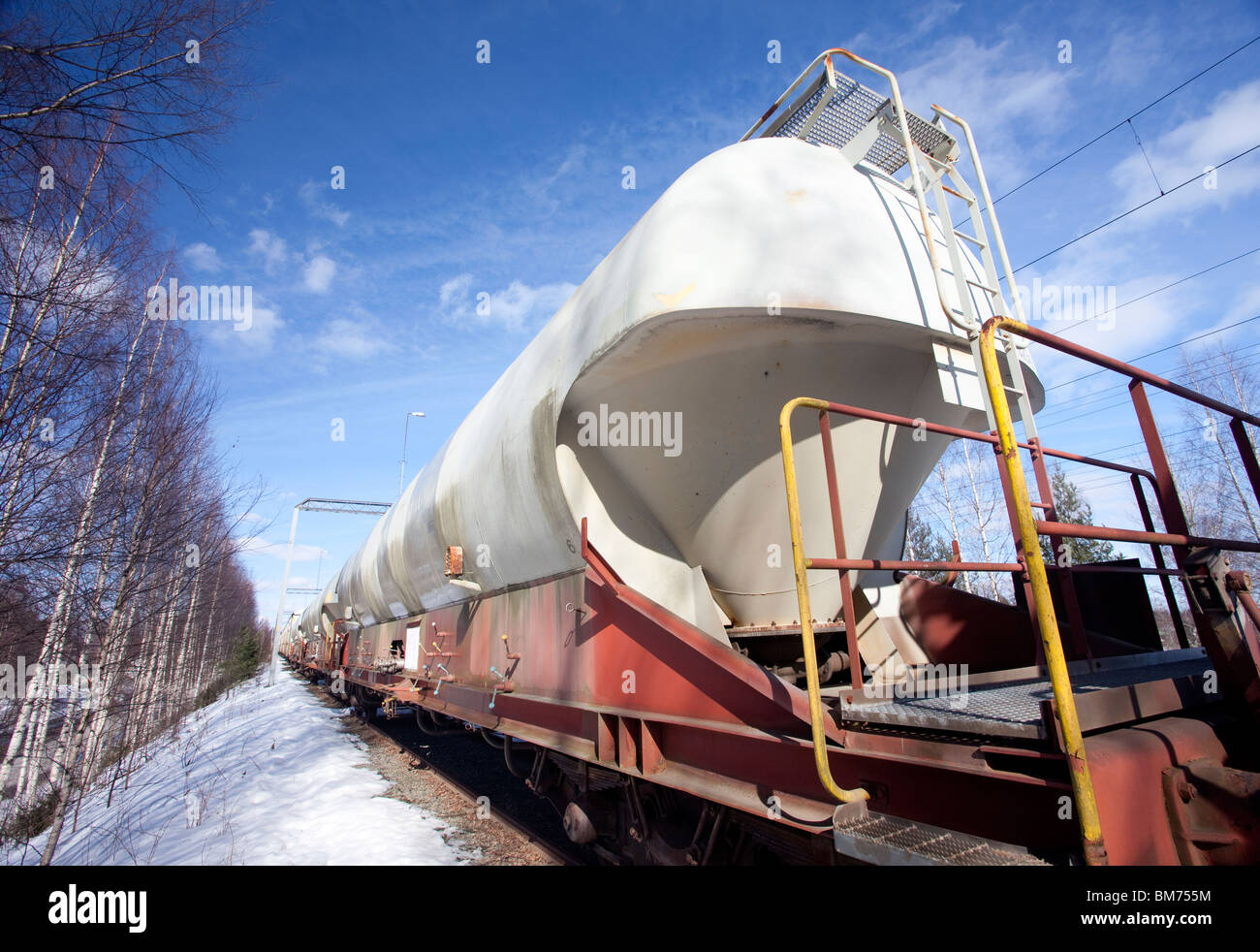 Long tanker train transporting chemicals to industry , Finland - Stock Image